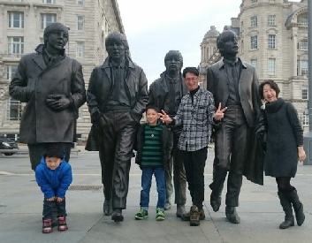 Beatles fans at the new Beatles Statues on their Beatles tour of Liverpool